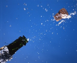 champagne_cork_popping_flying_water_liquid_drops_on_blue_AJHD.jpg